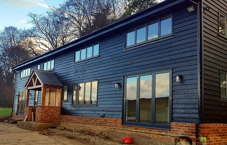 Crittal replacement aluminium windows and bifold doors in anthracite grey, installed by Harp.