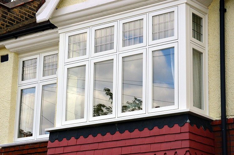 FLUSH white wood casements with leaded fanlights 750