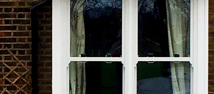 An older style uPVC sash window with bolt-on sash horns. (Look closely and you will see the join).