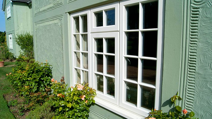 Evolution STORM casement window with ovolo putty Georgian bars.